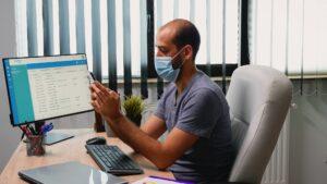 Typing on phone wearing mask